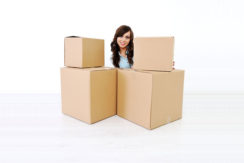 young woman in a room with boxes for moving